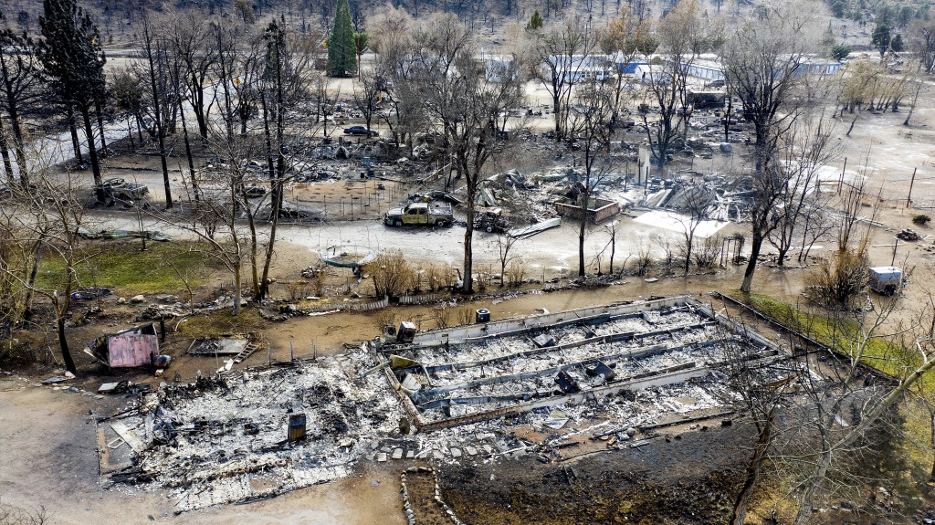 In this photo taken by a drone, homes destroyed by the Mountain View Fire are seen in the Walker community in Mono County, Calif., Wednesday, Nov. 18,...