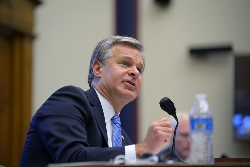 FILE - In this Sept. 17, 2020, file photo Federal Bureau of Investigation Director Christopher Wray testifies before a House Committee on Homeland Sec...