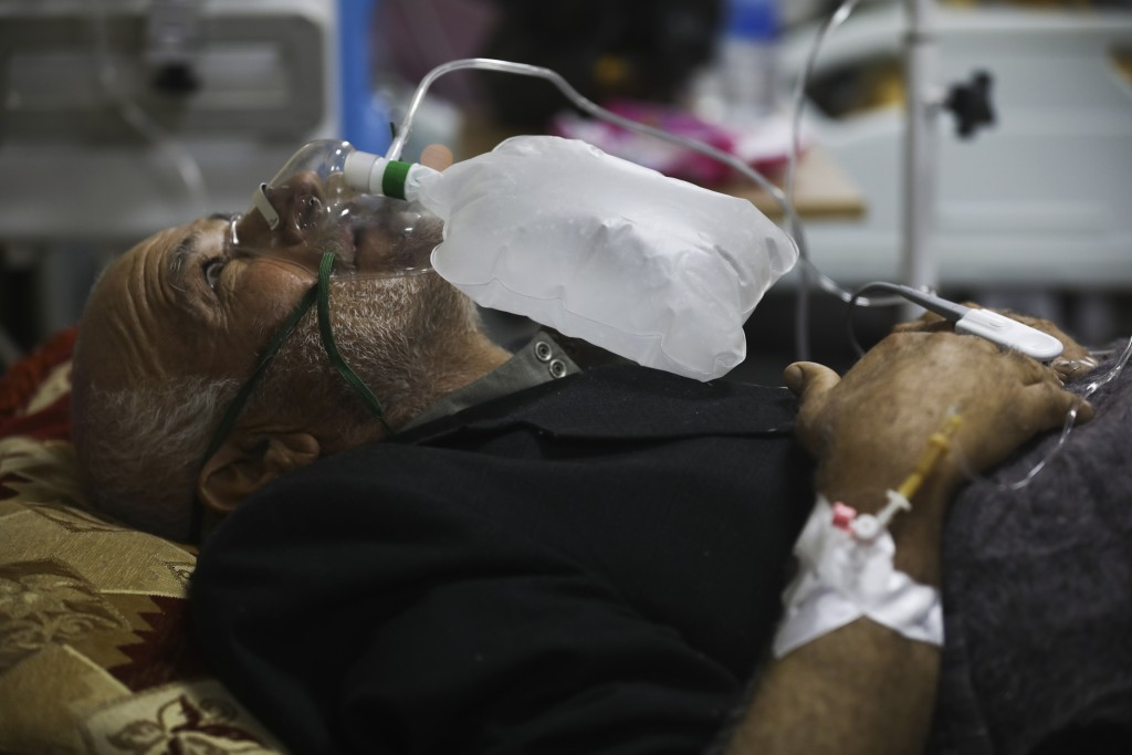 A corona patient receives oxygen in a hospital in Idlib, Syria, Saturday, Nov. 14, 2020. At one of two coronavirus hospitals in Syria's rebel-held Idl...