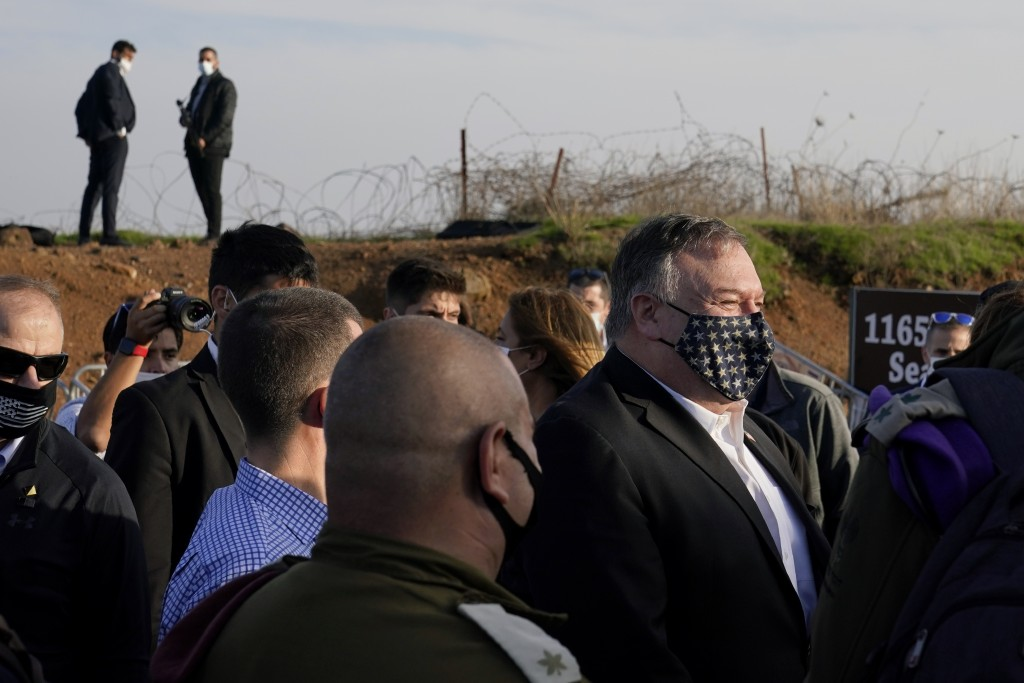 Secretary of State Mike Pompeo, right, arrives for a security briefing on Mount Bental in the Israeli-controlled Golan Heights, near the Israeli-Syria...