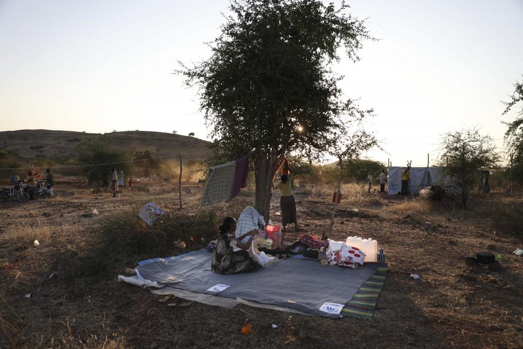 Ethiopian refugees gather in Qadarif region, easter Sudan, Wednesday, Nov 18, 2020. The U.N. refugee agency says Ethiopia's growing conflict has resul...