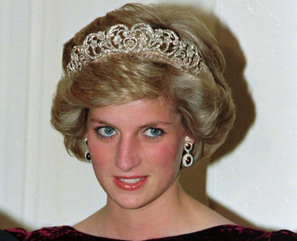 FILE - In this file photo dated Nov. 7, 1985, Britain's Princess Diana wears the Spencer tiara as she and Prince Charles attend state dinner at Govern...