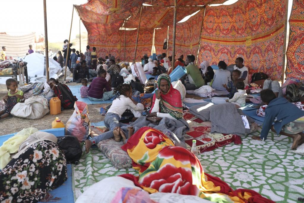 Ethiopian refugees gather in Qadarif region, easter Sudan, Friday, Nov 20, 2020. Thousands of Ethiopians fled the war in Tigray region into Sudan. (AP...
