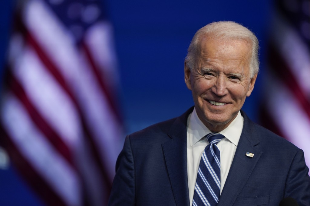 FILE - In this Nov. 10, 2020, file photo President-elect Joe Biden smiles as he speaks at The Queen theater in Wilmington, Del. President-elect Biden ...