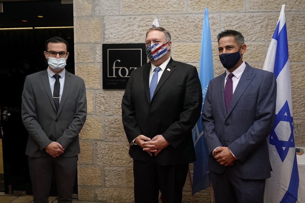 Secretary of State Mike Pompeo, center, poses for a photo with Daniel Voiczek, left, general manager and CEO of the Friends of Zion Museum, and Nir Ki...