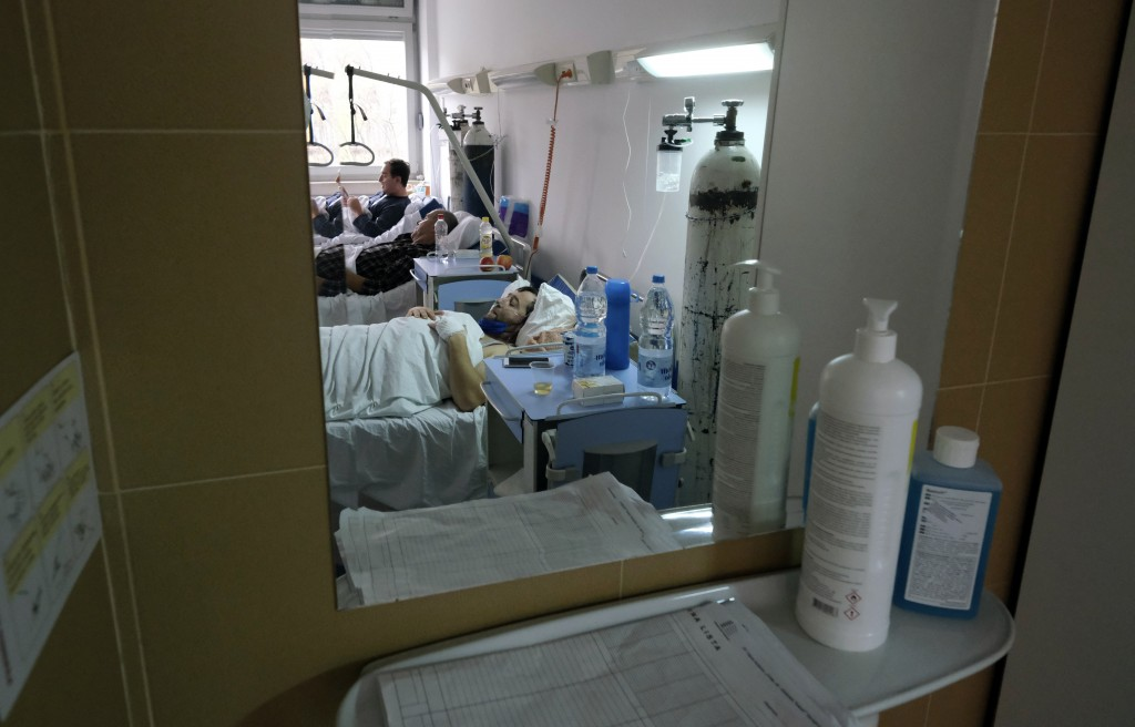 Patients on oxygen support lie in bed in the COVID-19 ward at a former military hospital in the capital Sarajevo, Bosnia, Thursday, Nov. 19, 2020. Doc...