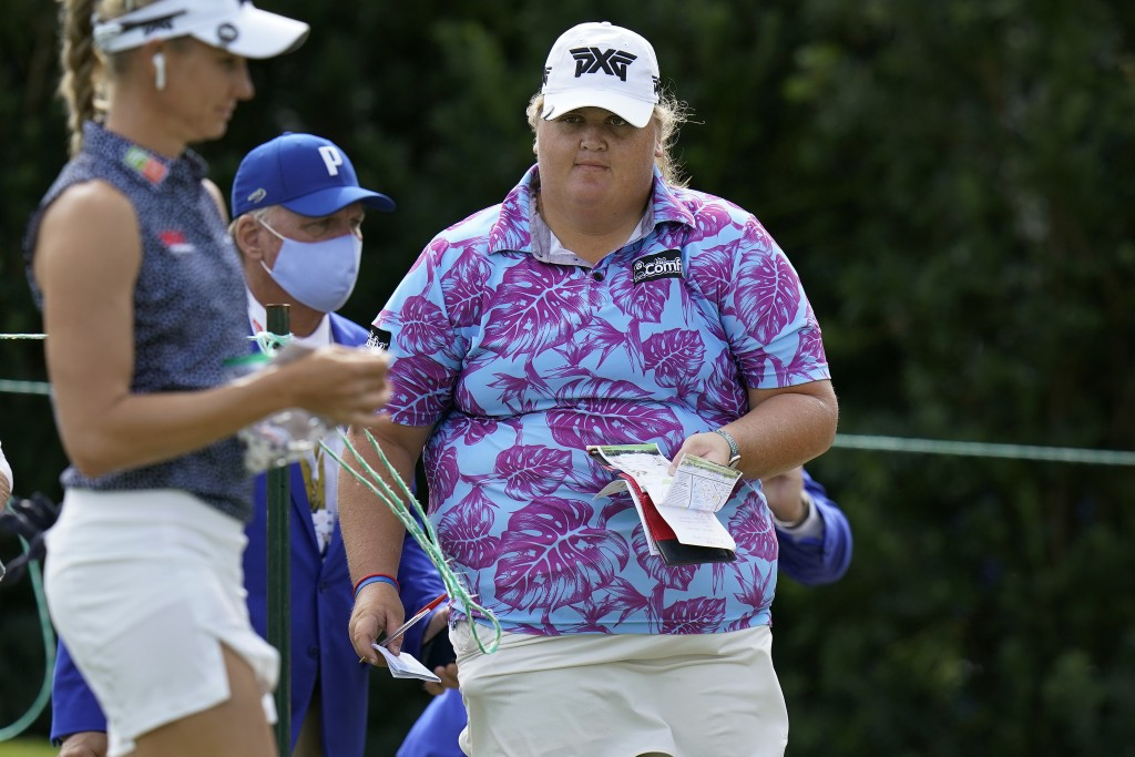 Haley Moore, right, walks to the tee on the first hole during the first round of the LPGA Pelican Women's Championship golf tournament Thursday, Nov. ...