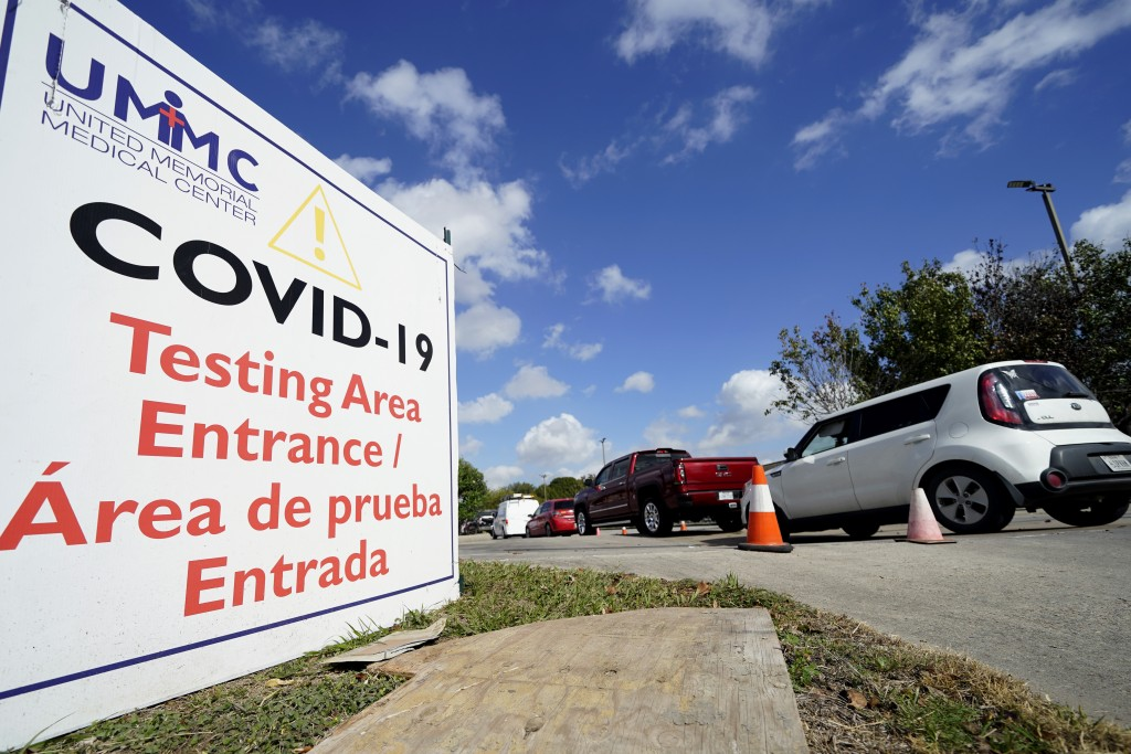 Drivers wait in line at a United Memorial Medical Center COVID-19 testing site Thursday, Nov. 19, 2020, in Houston.  Texas is rushing thousands of add...