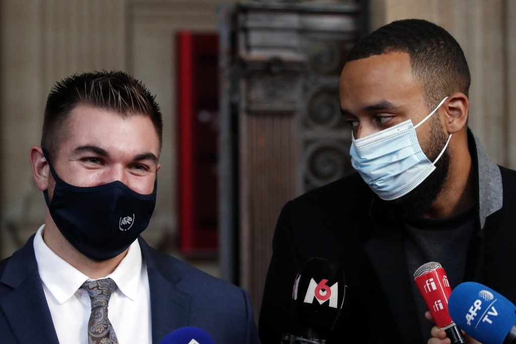 Alek Skarlatos, left, and Anthony Sadler, right, deliver a speech during the Thalys attack trial at the Paris courthouse, Friday, Nov. 20, 2020. Passe...
