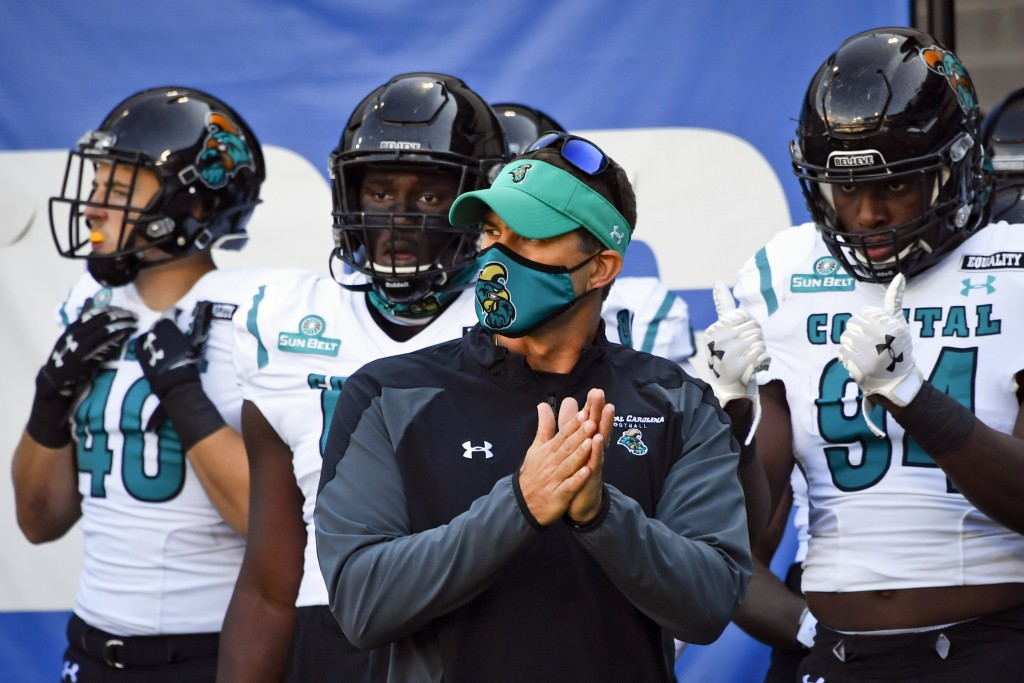 FILE - In this Saturday, Oct. 31, 2020, file photo, Coastal Carolina head coach Jamey Chadwell waits to lead his team onto the field before an NCAA fo...
