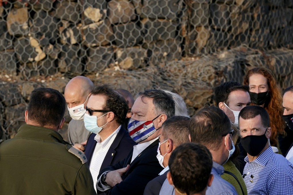 Secretary of State Mike Pompeo, center, takes part in a security briefing on Mount Bental in the Israeli-controlled Golan Heights, near the Israeli-Sy...