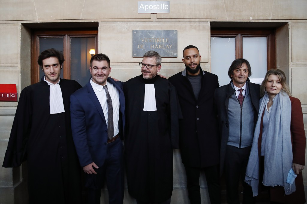 From left, lawyer Louis Cailliez, Alek Skarlatos, lawyer Thibault de Montbrial, Anthony Sadler, Mark Moogalian and Isabelle Risacher Moogalian, pose a...