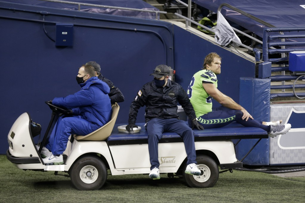 Seattle Seahawks tight end Greg Olsen (88) is taken off the field on a cart after going down with an injury against the Arizona Cardinals during the s...