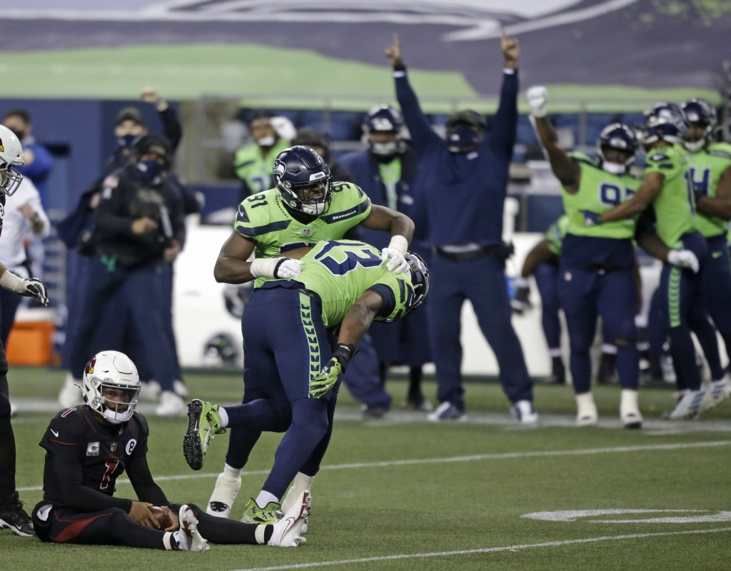 Seattle Seahawks defensive end Carlos Dunlap (43) celebrates with defensive end L.J. Collier (91) after Dunlap sacked Arizona Cardinals quarterback Ky...