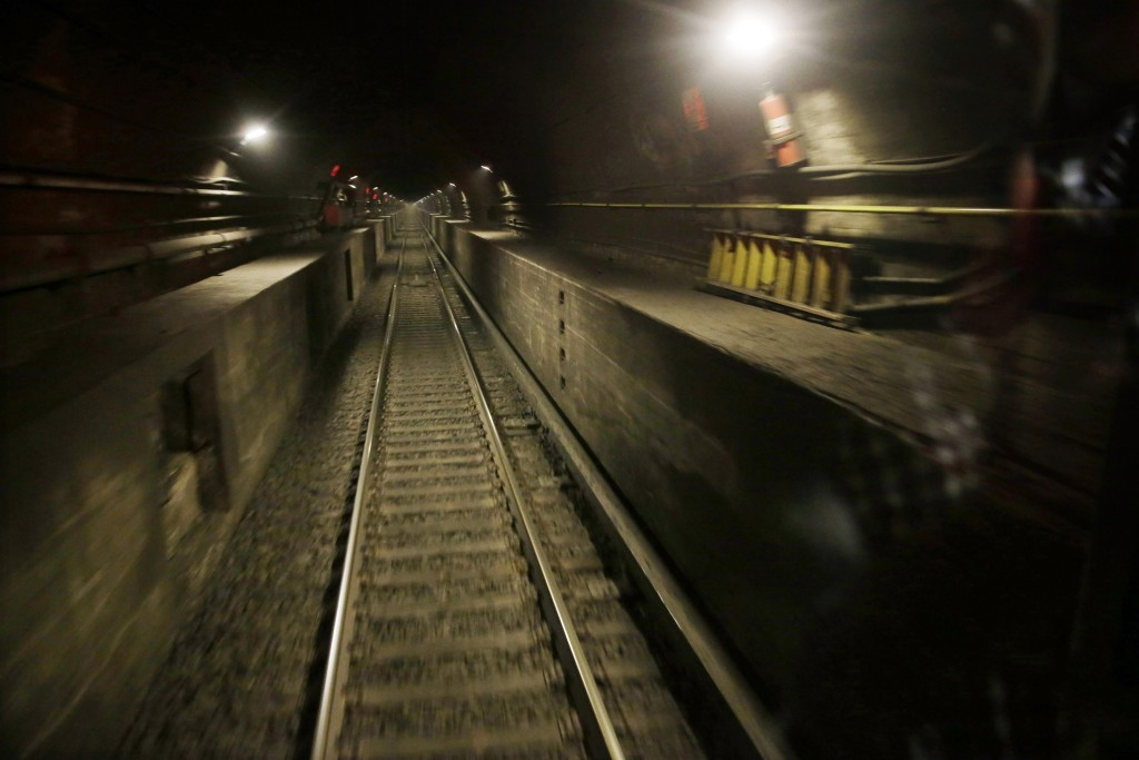 FILE - This Aug. 17, 2015 file photo shows a train tunnel under the Hudson River in North Bergen, N.J., as seen from the back of an Amtrak train bound...