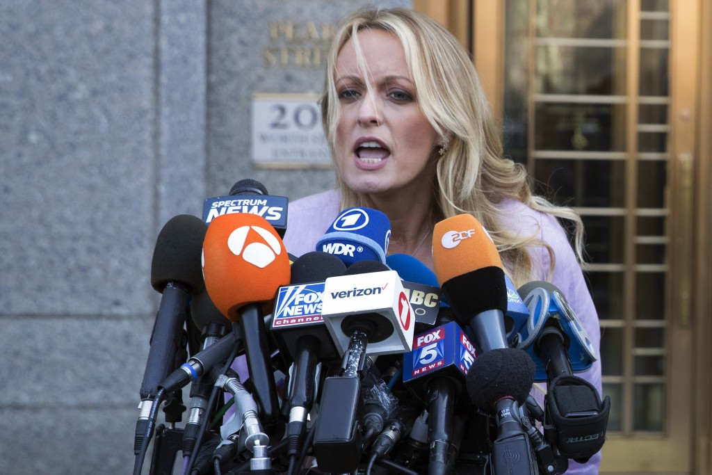 In this April 16, 2018 file photo, adult film actress Stormy Daniels speaks outside federal court in New York. Part of a criminal investigation by the...