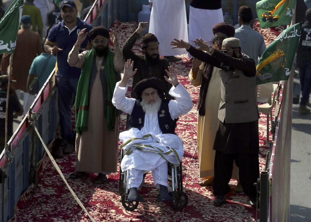 FILE - In this Saturday, Nov. 7, 2020 file photo, Khadim Hussein Rizvi, center on wheelchair, head of 'Tehreek-e-Labaik Pakistan, a religious politica...