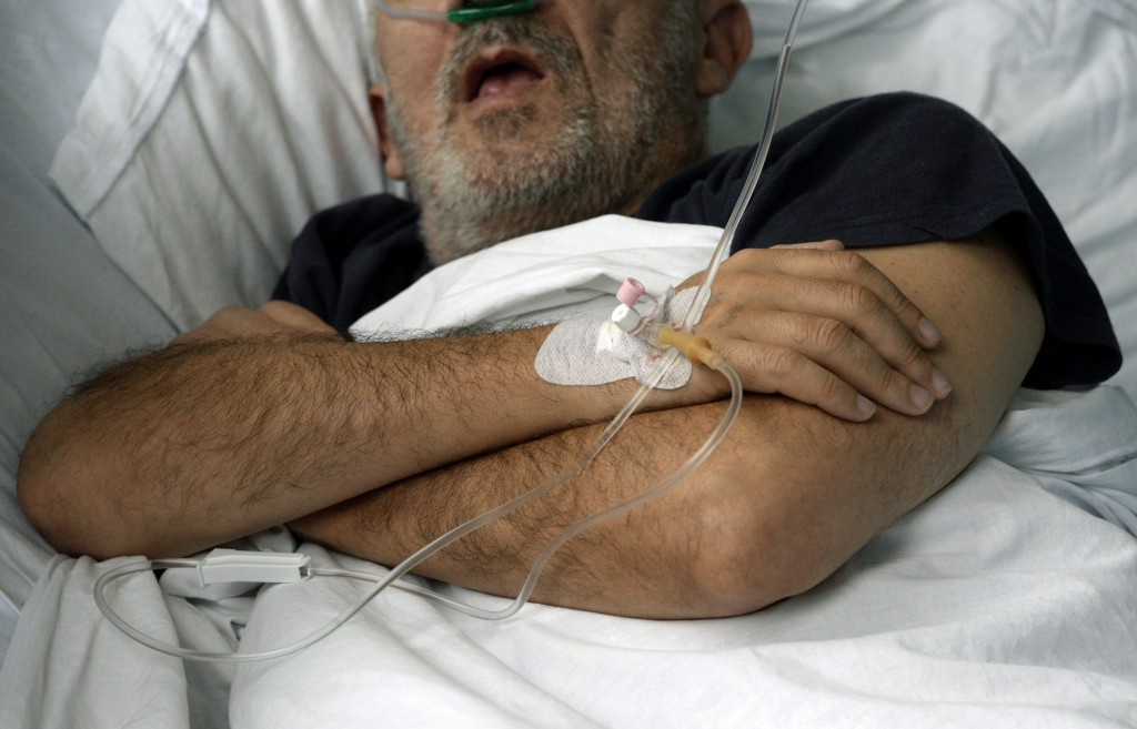 A patient on oxygen support is seen in the COVID-19 ward at a former military hospital in the capital Sarajevo, Bosnia, Thursday, Nov. 19, 2020. Docto...