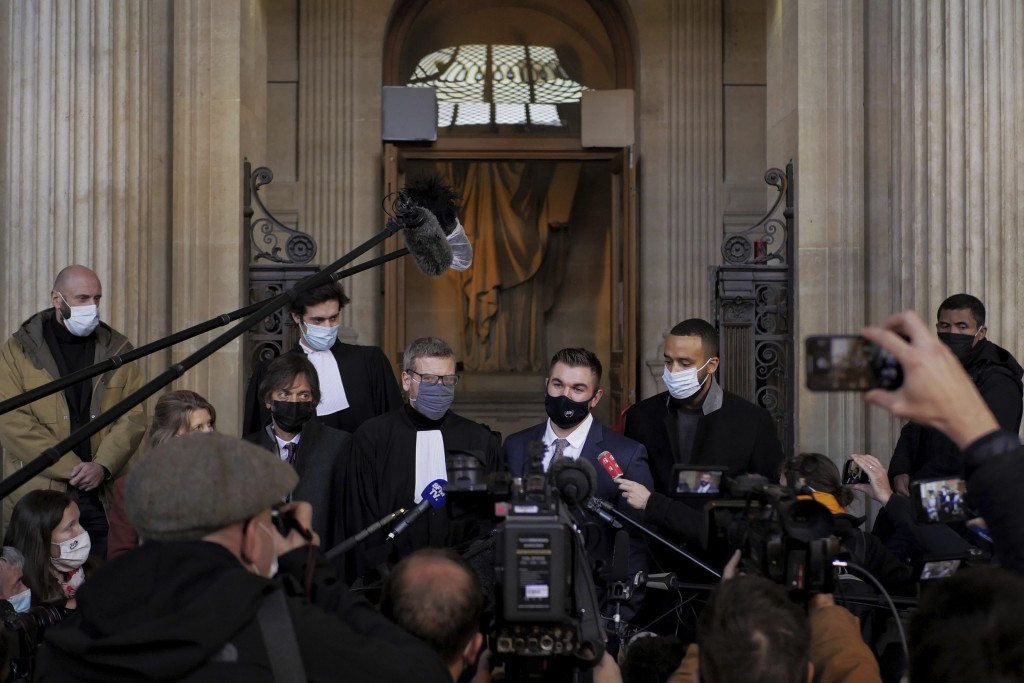 Alek Skarlatos, center right, Anthony Sadler, right, Mark Moogalian, left, and their lawyer Thibault de Montbrial, center left, deliver a speech durin...