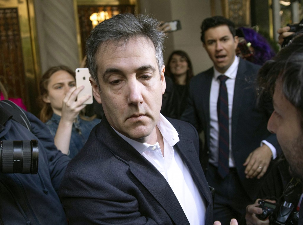 FILE - In this May 6, 2019, file photo, Michael Cohen, former attorney to President Donald Trump, leaves his apartment building before beginning his p...