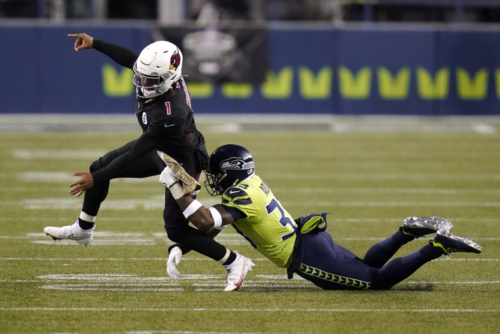 Seattle Seahawks strong safety Jamal Adams, right, gets to Arizona Cardinals quarterback Kyler Murray (1) just as Murray gets a pass off, during the s...