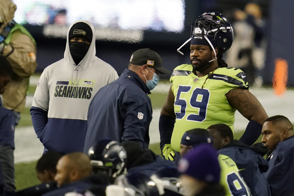 Seattle Seahawks defensive tackle Damon Harrison (59) stands on the sideline during the first half of an NFL football game against the Arizona Cardina...