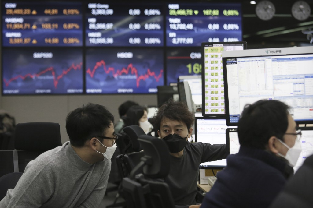 Currency traders work at the foreign exchange dealing room of the KEB Hana Bank headquarters in Seoul, South Korea, Friday, Nov. 20, 2020. Asian share...