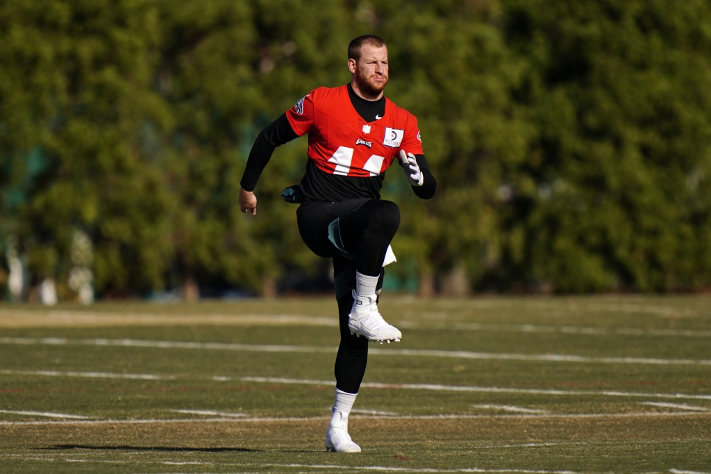Philadelphia Eagles' Carson Wentz stretches before practice at the NFL football team's training facility, Thursday, Nov. 19, 2020, in Philadelphia. (A...