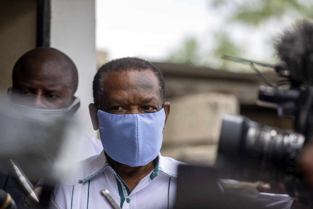 FILE - In this file photo dated Thursday, May 21, 2020, Yves Jean-Bart, president of the Haitian Football Federation, wearing a protective face mask, ...