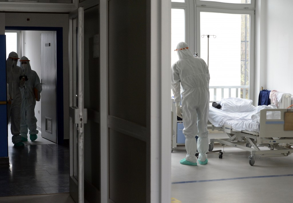 Nurses and other staff take care of patients with COVID-19 at a former military hospital in the capital Sarajevo, Bosnia, Thursday, Nov. 19, 2020. Doc...