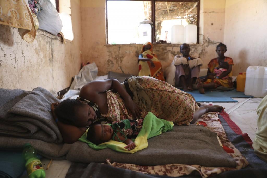 Ethiopian refugees rest in Qadarif region, easter Sudan, Friday, Nov 20, 2020. Thousands of Ethiopians fled the war in Tigray region into Sudan. (AP P...