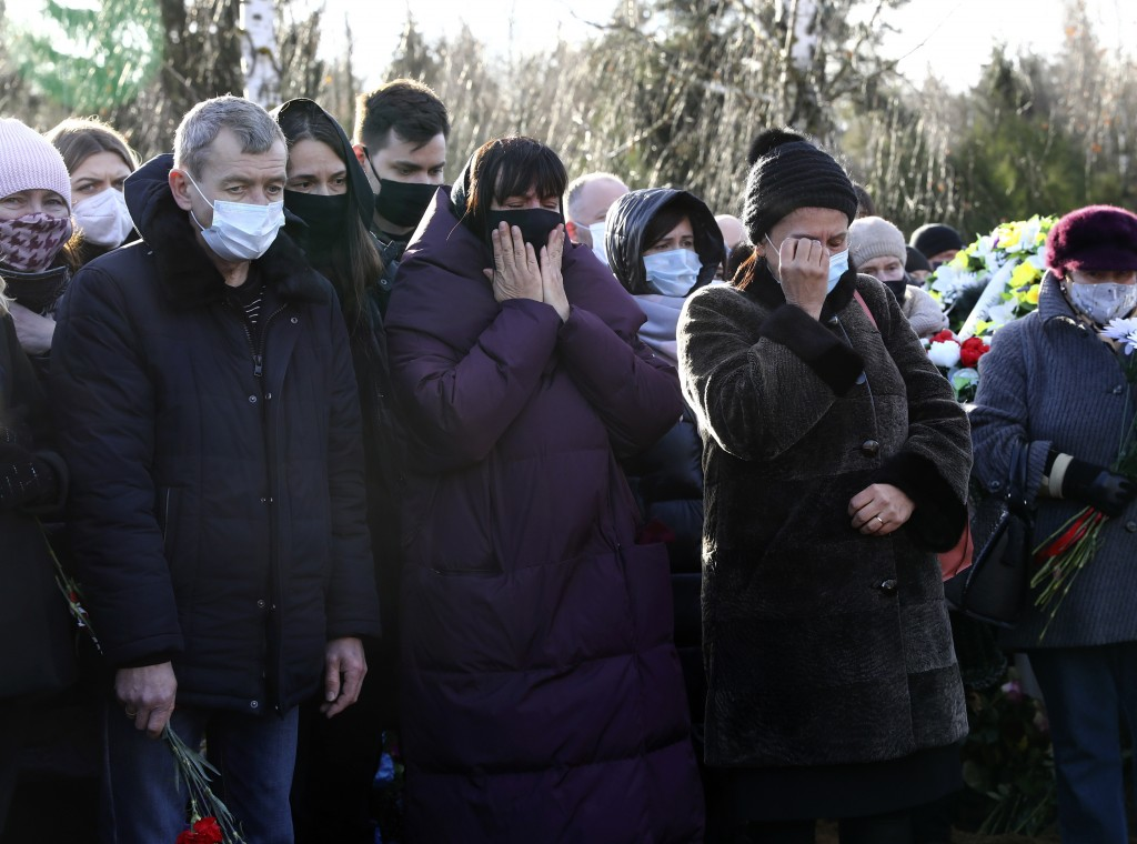 People cry as they pay their respects to Roman Bondarenko, an anti-government protester who died in hospital following what witnesses said was a sever...