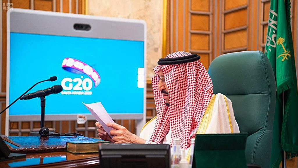 FILE - In this March 26, 2020, file photo released by Saudi Press Agency, SPA, Saudi King Salman, chairs a video call of world leaders from the Group ...