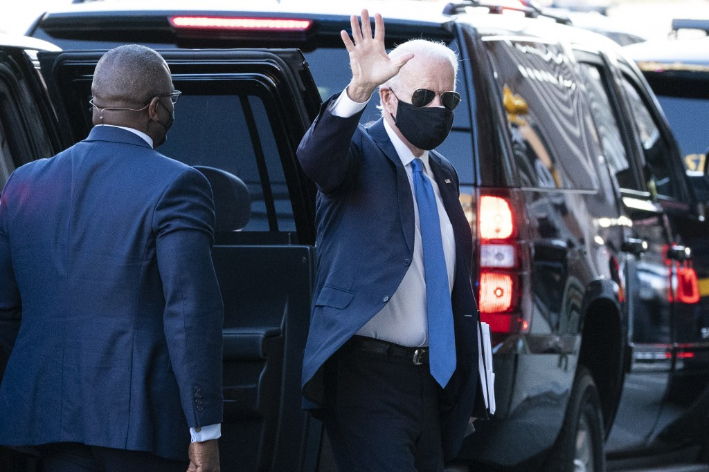 President-elect Joe Biden waves as he arrives The Queen theater for a meeting with Vice President-elect Kamala Harris, Senate Minority Leader Chuck Sc...