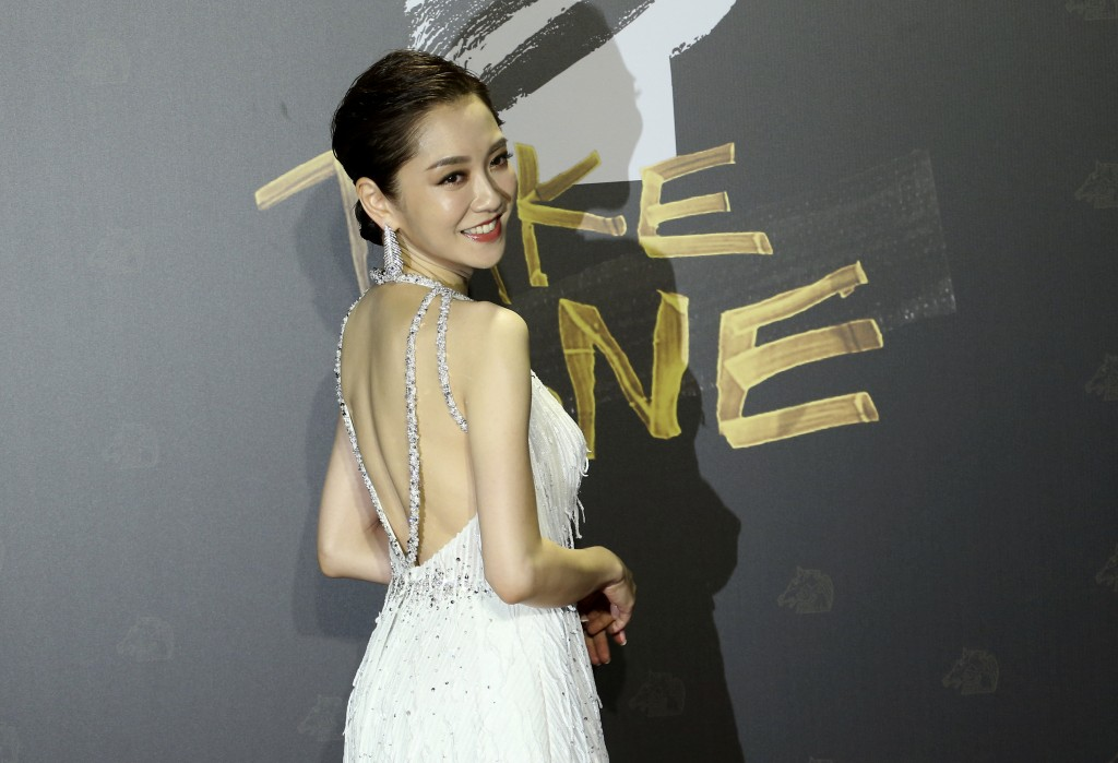 Taiwanese actress Pink Yang arrives at the 57th Golden Horse Awards in Taipei, Taiwan, Saturday, Nov. 21, 2020. Yang is a host at this year's Golden H...