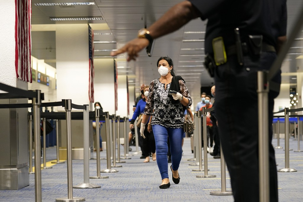 International passengers arrive at Miami international Airport where they are screened by U.S. Customs and Border Protection (CBP) using facial biomet...