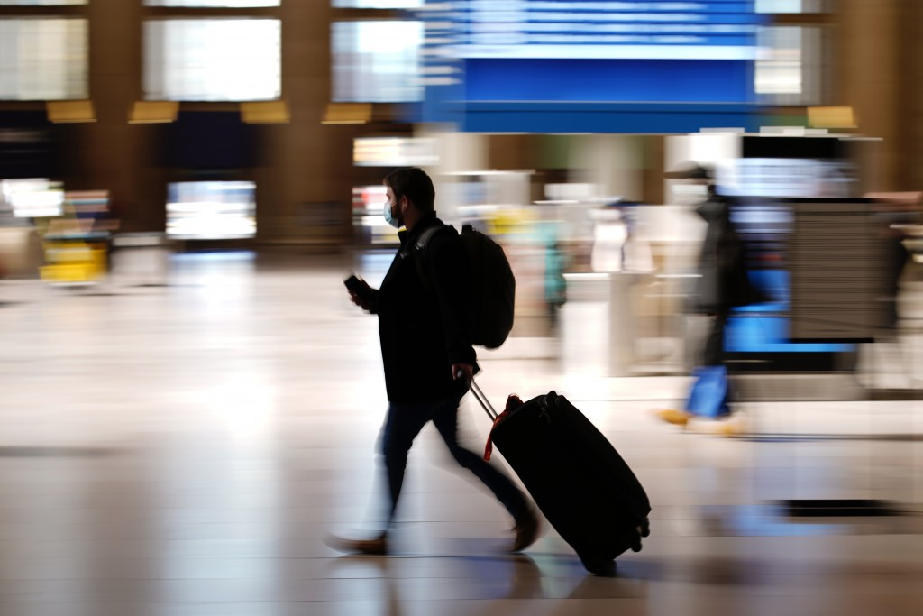 A man walks through the 30th Street Station ahead of the Thanksgiving holiday, Friday, Nov. 20, 2020, in Philadelphia. With the coronavirus surging ou...