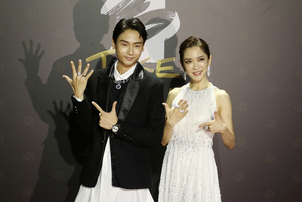 Taiwanese actress Pink Yang, right, and actor Da-her Lin arrives at the 57th Golden Horse Awards in Taipei, Taiwan, Saturday, Nov. 21, 2020. They are ...
