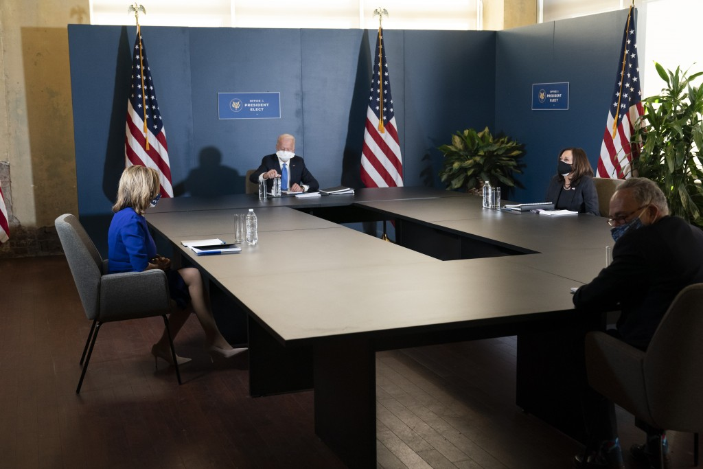 President-elect Joe Biden, speaks during a meeting with Vice President-elect Kamala Harris, right, Senate Minority Leader Chuck Schumer of N.Y., and H...