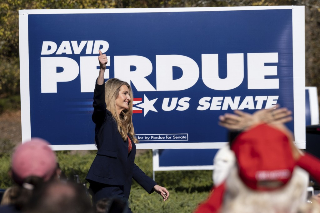 Sen. Kelly Loeffler, R-Ga., takes the stage before Vice President Mike Pence during a Defend the Majority Rally, Friday, Nov. 20, 2020 in Canton, Ga. ...
