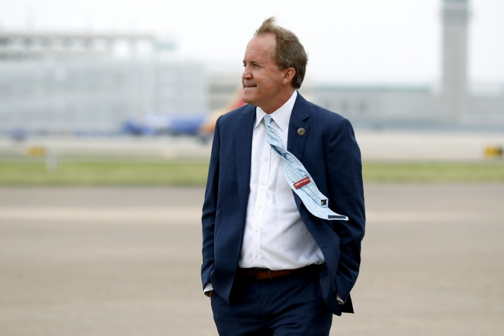 FILE - In this June 28, 2020, file photo, Texas Attorney General Ken Paxton waits on the flight line for the arrival of Vice President Mike Pence at L...