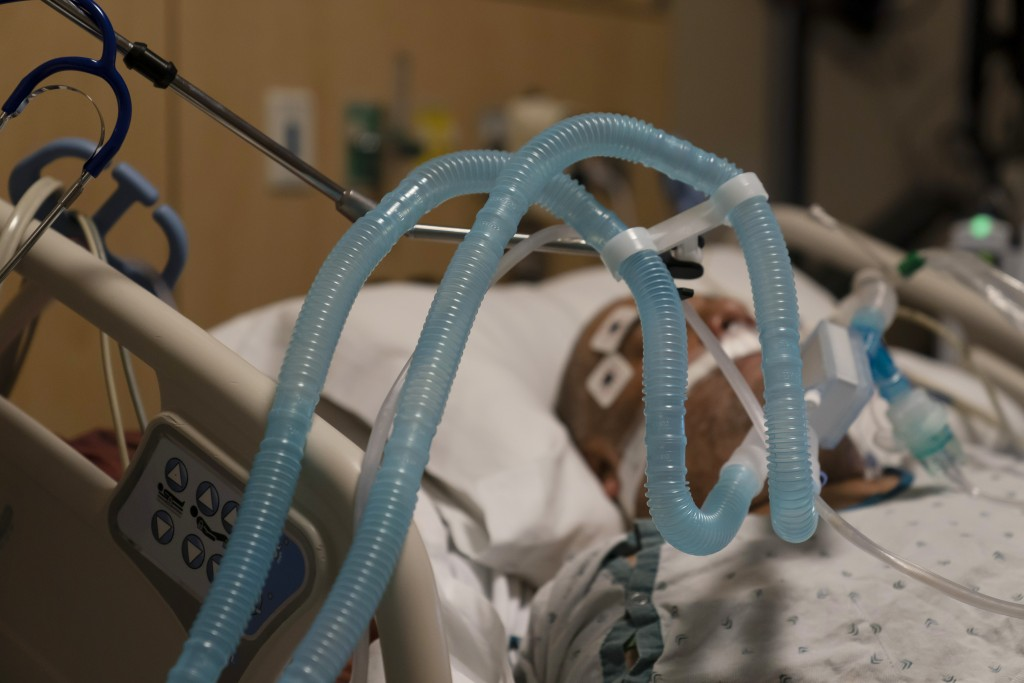FILE - In this Nov. 19, 2020, file photo, ventilator tubes are attached to a COVID-19 patient at Providence Holy Cross Medical Center in the Mission H...