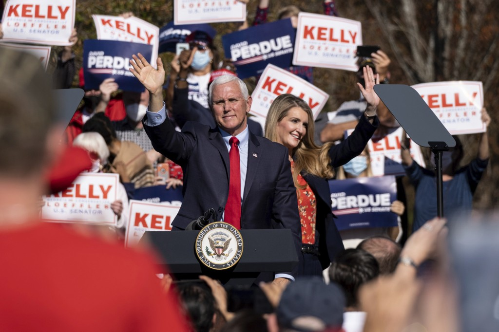Vice President Mike Pence and Kelly Loeffler wave to the crowd during a Defend the Majority Rally, Friday, Nov. 20, 2020 in Canton, Ga. U.S. Sen. Kell...