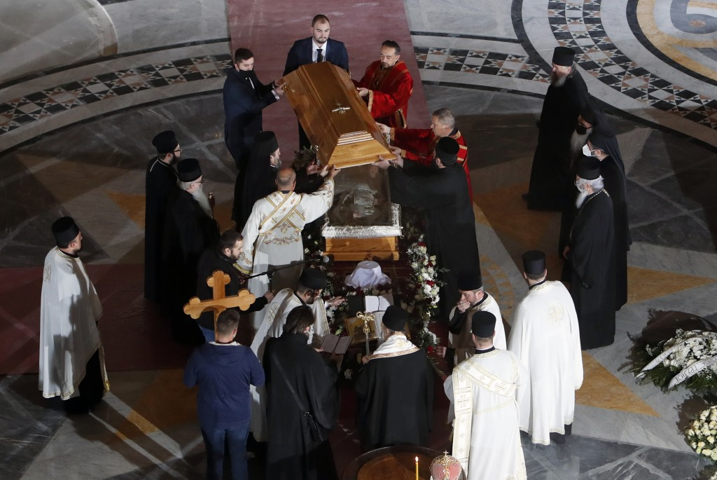 Church leaders open the coffin of Patriarch Irinej during the procession at the St. Sava Temple in Belgrade, Serbia, Saturday, Nov. 21, 2020. Patriarc...