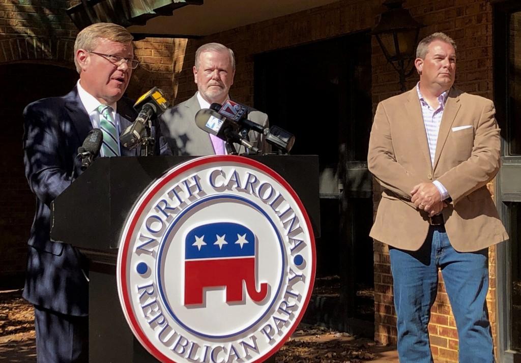 FILE - North Carolina House Speaker Tim Moore, left, R-Cleveland, speaks to reporters, with Senate leader Phil Berger, R-Rockingham, and House Majorit...