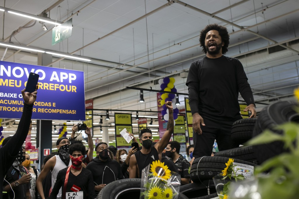 Activists including members of Black Lives Matter demonstrate inside a Carrefour supermarket against the murder of Black man Joao Alberto Silveira Fre...