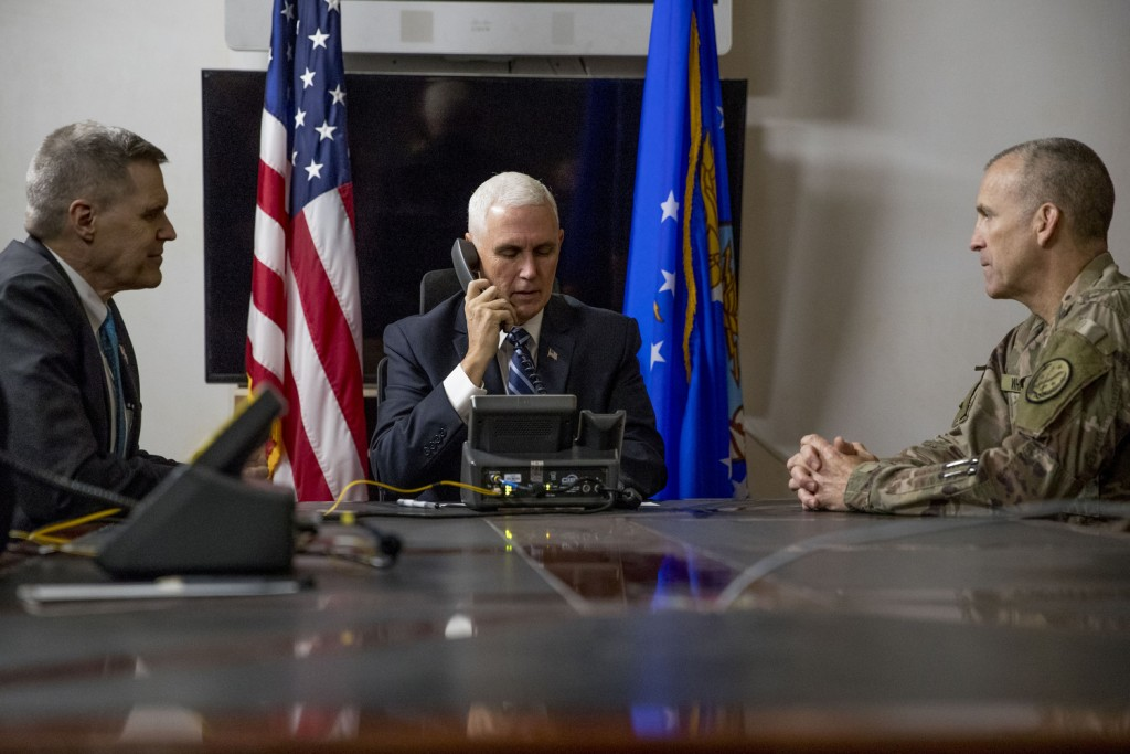 FILE - In this Nov. 23, 2019, file photo Vice President Mike Pence, accompanied by U.S. Ambassador to Iraq Matthew Tueller, left, and Lt. Gen. Pat Whi...
