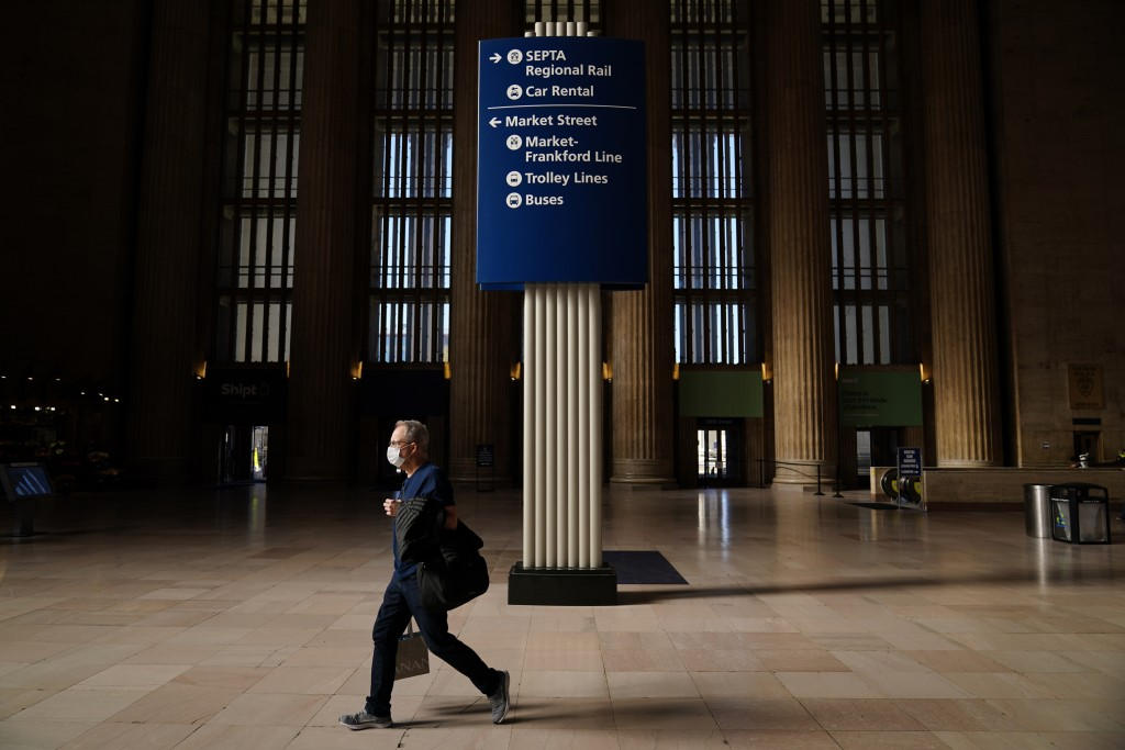 A traveler walks through the 30th Street Station ahead of the Thanksgiving holiday, Friday, Nov. 20, 2020, in Philadelphia. With the coronavirus surgi...