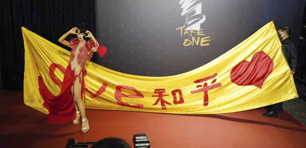 "Chinese-American actress Bai Ling poses with her slogan ""Love, Peace"" at the 57th Golden Horse Awards in Taipei, Taiwan, Saturday, Nov. 21, 2020. Bai ..."