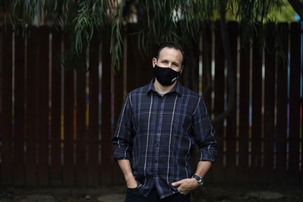Nicholas Philbrook poses for a photo in his backyard, Wednesday, Nov. 18, 2020, in Camarillo, Calif. Philbrook has been trying to convince court offic...